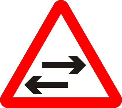Two-way traffic on route crossing ahead road sign