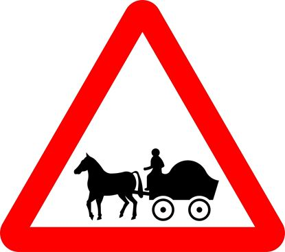 Horse drawn vehicles likely to be road ahead road sign