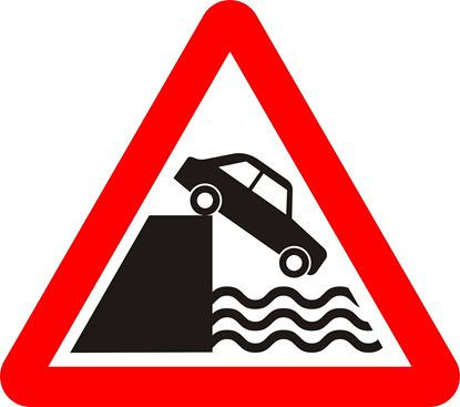 Quayside or river bank ahead road sign