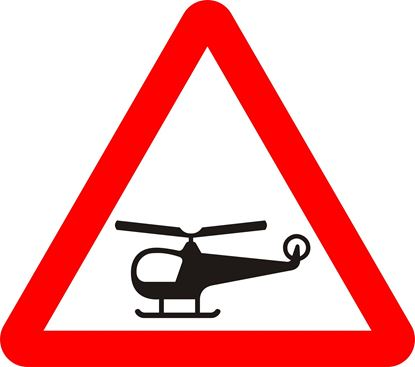 Low flying helicopters or sudden helicopter noise likely ahead road sign