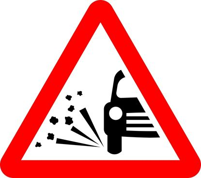 Loose chippings on road ahead road sign