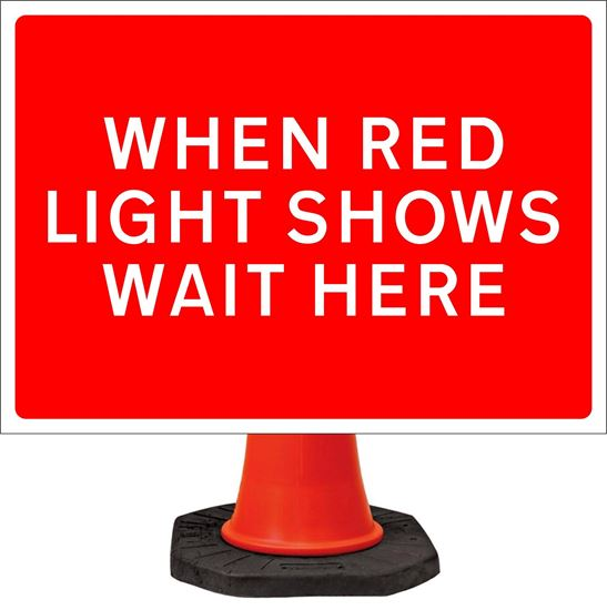 When red light shows wait here road signs